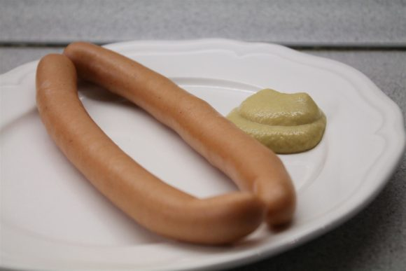 Boiled hot dog with mustard