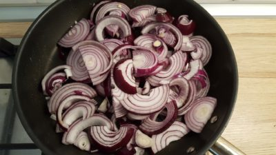 Caramelized red onions recipe 2 - red onion slices in a non-stick skillet